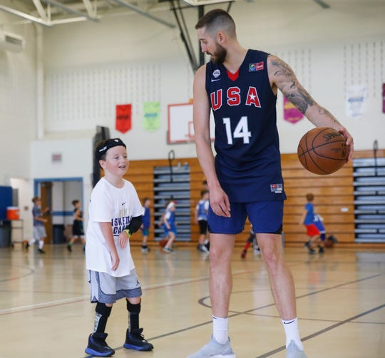 Tyler Lydon works with Roger Loughran during the Tyler Lydon Basketball Camp at Stissing Mountain High School on August 8, 2019.