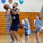 Tyler Lydon takes a jump shot alongside, from  left,  Gracyn and Maddie Clements during the Tyler Lydon Basketball Camp at Stissing Mountain High School on August 8, 2019.