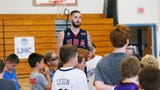 Tyler Lydon returned to his old high school in Pine Plains to host his annual basketball camp. He then got the work from 9-year-old Roger Loughran.