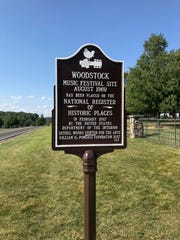 A sign at the site of the Woodstock festival denotes its placement on the National Register of Historic Places.