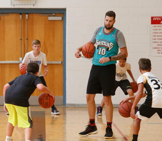 Director of operations for LMC Camps Zach Lydon gives instructions to campers during the Tyler Lydon Basketball Camp at Stissing Mountain High School on August 8, 2019.