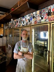 "Mark Moore runs a deli and souvenir shop he calls the ""Woodstock Oasis Country Store"" in Bethel, New York."
