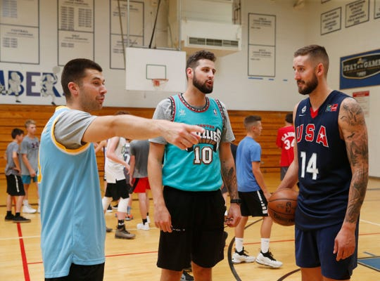 From left, camp director Justin Cooper, director of operations for LMC Camps Zach Lydon and Tyler Lydon talk about a drill during the Tyler Lydon Basketball Camp at Stissing Mountain High School on August 8, 2019.