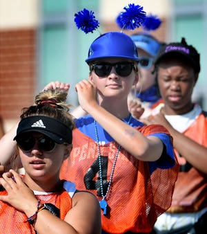 """Central York High School junior Sarah Kruza wears a costume during a Panther Marching Band practice at the school Thursday, Aug. 8, 2019. Band members participated in a """"color war"""" during the session, with class members wearing the grade's designated color. Prizes were awarded for costume creativity. Band members were completing the week's main band camp schedule which is comprised of daily 10-hour sessions. They practice without instruments while learning the show's choreography. The first football game is Aug. 23 at West York. Bill Kalina photo"""