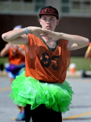 """Central York High School sophomore Connor Funk wears a tutu during a Panther Marching Band practice at the school Thursday, Aug. 8, 2019. Band members participated in a """"color war"""" during the session, with class members wearing the grade's designated color. Prizes were awarded for costume creativity. Band members were completing the week's main band camp schedule which is comprised of daily 10-hour sessions. The first football game is Aug. 23 at West York. Bill Kalina photo"""