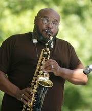 Jimmie Highsmith Jr. plays the saxophone with The Jimmie Highsmith Experience during the annual Clarissa Street Reunion on Clarissa Street in Corn Hill in Rochester, N.Y.  August 18 2012. Highsmith has shared the stage with multiple Grammy Award winners, including Najee, Alicia Keys and Wynton Marsalis.