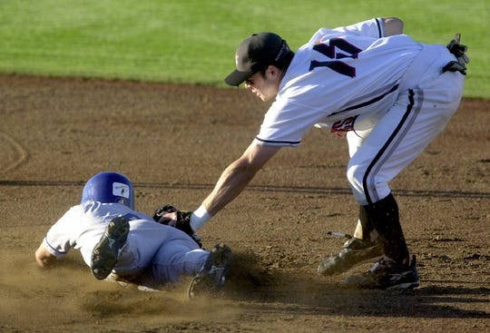 Salem-Keizer's Derin McMains (right) tags out Tri-City's Casey Lambert during an attempted steal at second base at Volcanoes' Stadium on Saturday July 7, 2001.