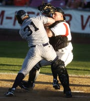 Salem-Keizer's catcher Jackson Williams tags Eugene's Danny Payne out at home Tuesday night July 31, 2007 at Volcanoes Stadium.