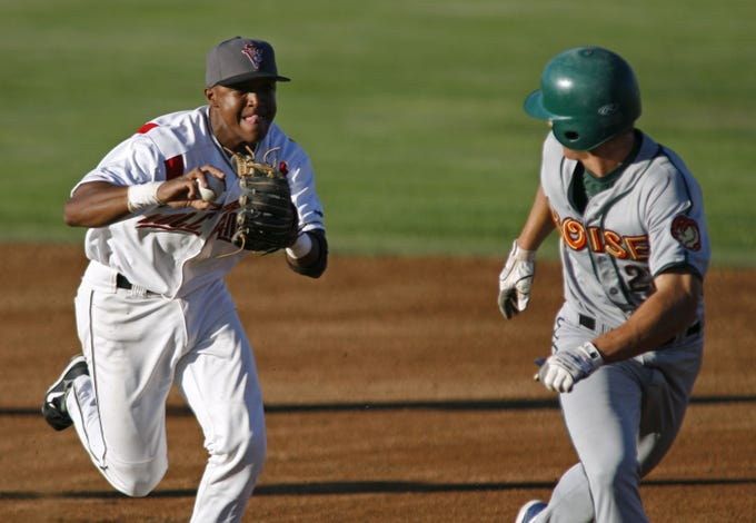 Salem-Keizer's Sharlon Schoop chase Boise's Kyler Burke during a run down in the first inning of their Northwest League game at Volcanoes Stadium on  Wednesday Aug. 8,  2007.Schoop tagged Burke out to end the inning. Photo by Timothy J. Gonzalez