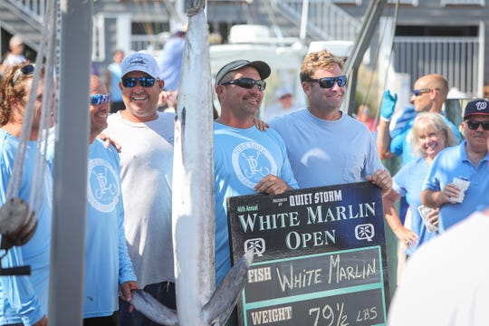 Tommy Hinkle and the crew of the Fish Whistle pose with the 79.5-pound white marlin they caught to take the lead at the White Marlin Open on Thursday, Aug. 8, in Ocean City.