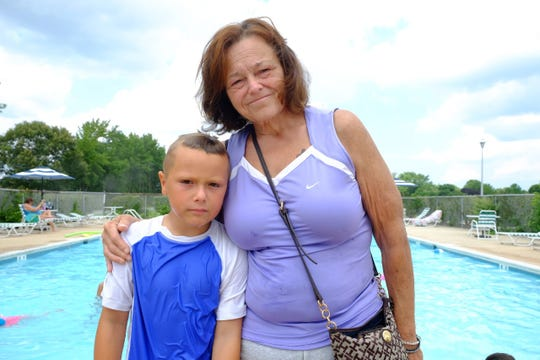 Robin Brown stands with her grandson Austin at the Rehoboth Shores community pool.