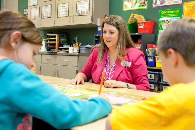 Brandon Valley Junior Achievement board chair Jenne VanWesten teaches a JA class last school year.