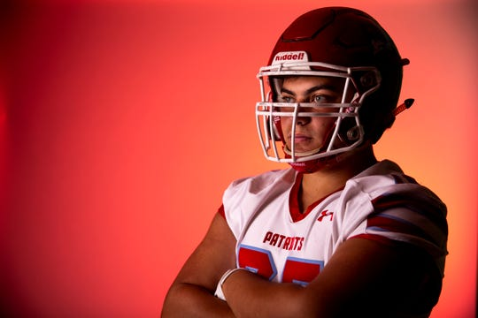 Defensive tackle Alex Oppold of Lincoln High School football team poses for a portrait during the Argus Leader football media day, Tuesday, Aug. 6.
