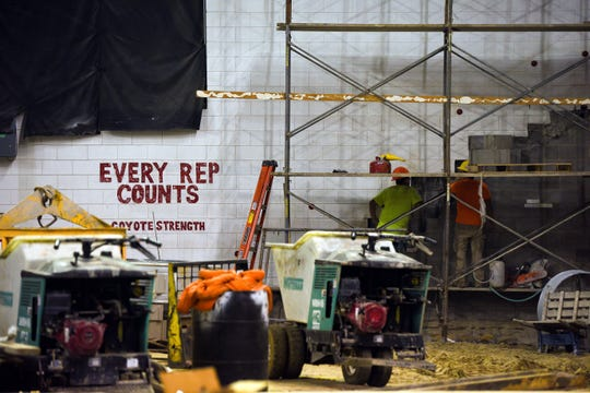 """The phrase """"every rep counts"""" is still visible painted on the wall of the DakotaDome during renovations on Tuesday, July 9, at the University of South Dakota in Vermillion."""