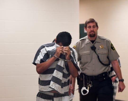 Joseph Andrews, 28, is escorted into Minnehaha County Court, Thursday, Aug. 8.