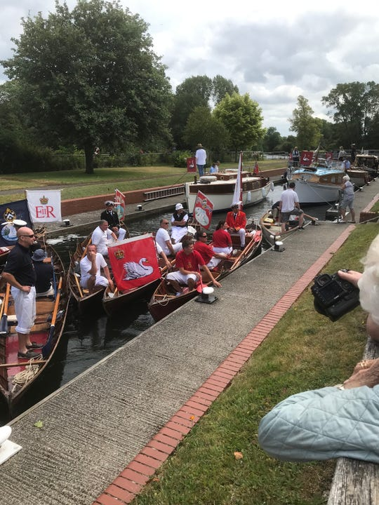 Boats wait in a lock on the Thames River during the swan upping in July.
