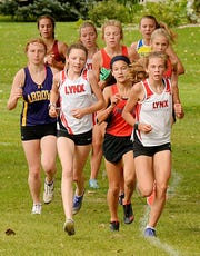Brandon Valley runners Mia Wentzy (left) and Gracyn Gruber compete in the Watertown Invitational last season.