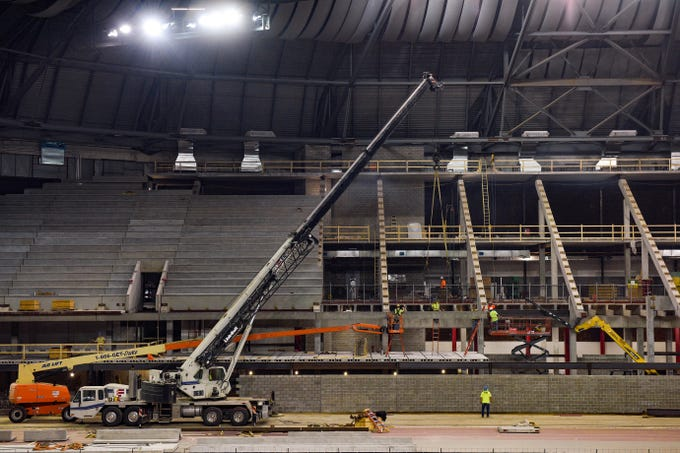 Concrete foundation is installed for rows of elevated seating  at the DakotaDome at the University of South Dakota on Wednesday, August 7, in Vermillion.