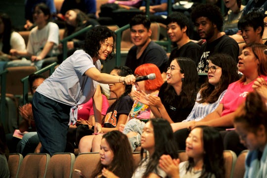Andie Kim gets students to sing along during the IYF World Camp on Wednesday, Aug. 7, 2019, in Springfield, Mo.