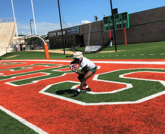 FAMU running back Terrell Jennings catches a touchdown pass during practice.