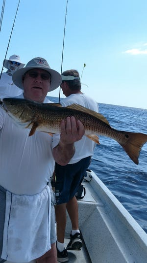 Mickey Andrews with one of several redfish caught While fishing with guide Junior Dice.