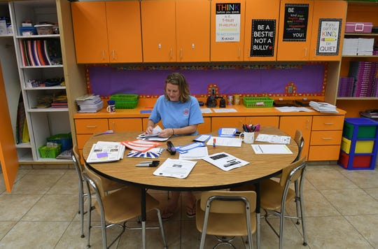 Pelican Island third grade teacher Sandy Shulock prepares her classroom on Thursday, Aug. 8, 2019, for the first day of school this coming Monday Aug. 12. Gov. Ron DeSantis announced his plan Monday to increase teacher pay during the next legislative session.