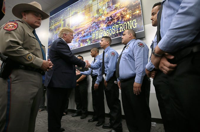 President Donald Trump thanks El Paso Firefighters who responded to the mass shooting at Walmart in El Paso, Texas during his visit Wednesday, August, 7, 2019. Trump visited University Medical Center where he met with vicims and later visited the Office of Emergency Management.
