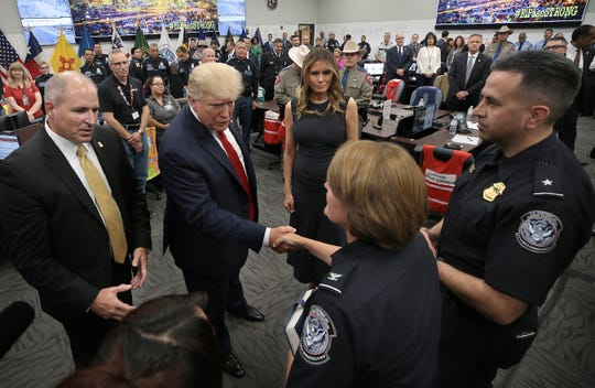 President Donald Trump meets CBP officer Donna Sifford who was shopping at Walmart at the time of the attack that killed 22 and injured 25 others. Sifford helped rescue people from the shooter.