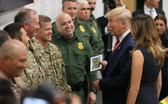 President Donald Trump, along with first lady Melania Trump, talk with Border Patrol agents Aug. 7, 2019, at the Office of Emergency Management in El Paso, Texas. Trump visited El Paso to meet with people who were wounded in the Aug. 3, 2019, attack at Walmart and first responders who were at the scene.