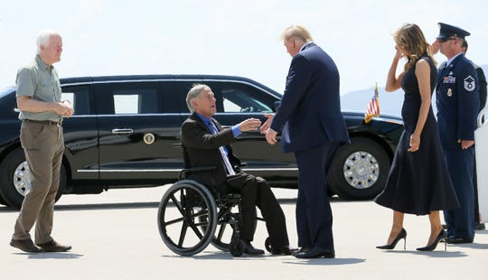 President Donald Trump and Melania Trump greet Texas Governor Greg Abbott after arriving in El Paso, Texas Wednesday, August, 7, 2019, to meet with law enforcement and Walmart shooting victims. Sen. John Cornyn is at left.