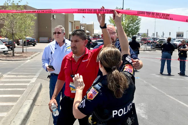 Walmart store manager Robert Evans goes to check on employees just after a gunman opened fire at the store near Cielo Vista Mall in East-Central El Paso on Saturday, Aug. 3, 2019.