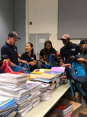Volunteers from The United Way of Ventura County are stuffing backpacks for their 2019 Stuff the Bus project.