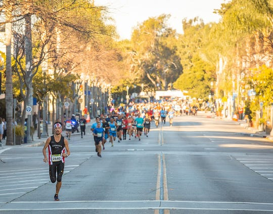 Runners take to Main Street during the Ventura Marathon. The event will include the first Ventura Brew Fest when it returns this fall.