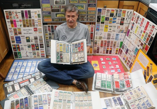 Wayne Eadie with some of the thousands of matchbooks that he has collected over the years, at his Goldens Bridge home Aug. 8, 2019. Wayne is also the Time and Place Chair for the Rathkamp Matchcover Society, which is having its 80th annual national convention of matchcover collectors in 2020