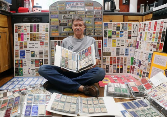 Wayne Eadie with some of the thousands of matchbooks that he has collected over the years, at his Goldens Bridge home Aug. 8, 2019. Wayne is also the Time and Place Chair for the Rathkamp Matchcover Society.