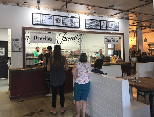 Customers order at the counter at the new Rise Up Coffee Roasters in Rehoboth Beach. You can take the food to tables both indoor and outdoors.