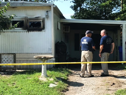 State fire marshals on Thursday were investigating a Long Neck fire that killed 3 children the day before.
