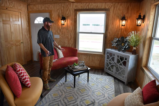 Scott Little, instructor for the Construction Technology class at the WFISD Career Education Center, talks about the house built by his students and five other trades taught at the CEC. The house will be auctioned August 13 at the CEC.
