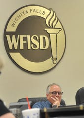 Wichita Falls Independent School District place 1 member, Bob Payton looks at the ISD's agenda during a special session held to discuss faculty salaries and long-term facilities plans.