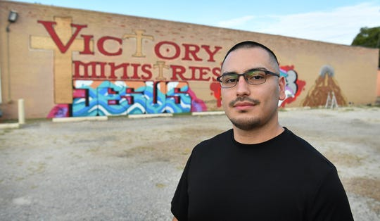 Mural artist Gabriel Corona has created a sign mural for his church, Victory Ministries on Monroe.