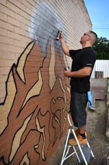 Mural artist Gabriel Corona uses specialized spray paints with different pressures and nozzle patterns to create his artwork.
