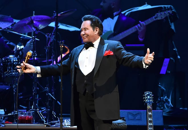 Singer Wayne Newton, seen performing in Las Vegas in 2016, is being sued by a woman who alleges his pet monkey bit and injured her daughter.