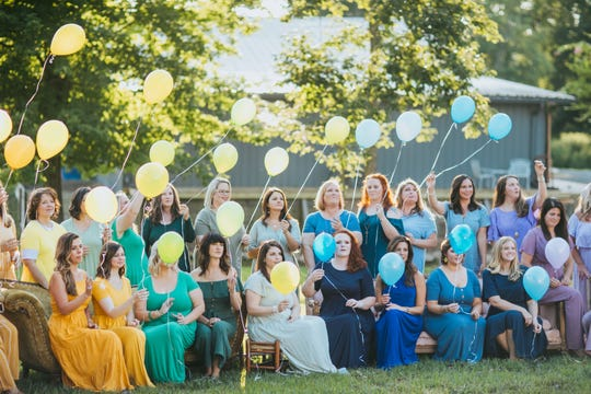 At the photo shoot, each mom received a balloon for a commemorative release, a moment to remember the babies they have lost.