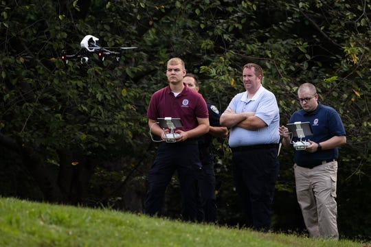 Investigators launch a drone at scene of a small plane crash in a residential neighborhood in Upper Moreland, Pa., Thursday, Aug. 8, 2019.
