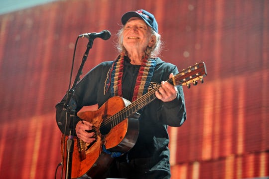Willie Nelson performs at Farm Aid in 2015. This year's Farm Aid will be a virtual concert benefiting farms impacted by COVID-19.