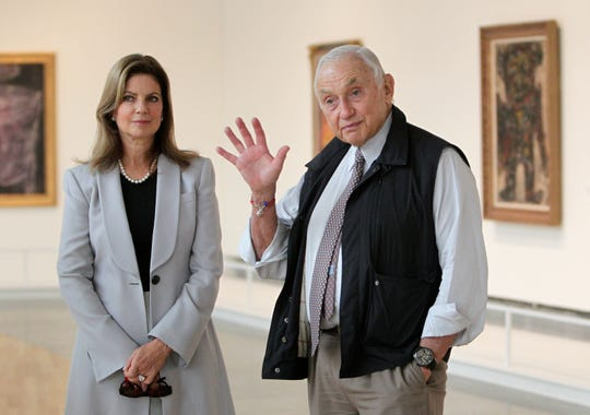 """This Sept. 19, 2014, file photo shows retail mogul Leslie Wexner, right, and his wife, Abigail, as they  tour the """"Transfigurations"""" exhibit at the Wexner Center for the Arts in Columbus, Ohio."""