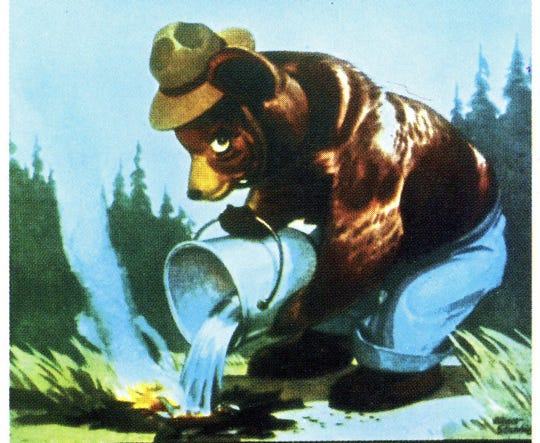 """Artist Albert Staehle created the first Smokey Bear poster in October 1944, seen here. At the time, the campaign used Smokey's original campaign slogan, """"Care will prevent 9 out of 10 forest fires!"""" In the years following, Smokey's campaign became famous for its cartoon artwork. The Smokey Bear Wildfire Prevention campaign serves as one of the longest-running public service advertising campaigns in the history of the United States."""