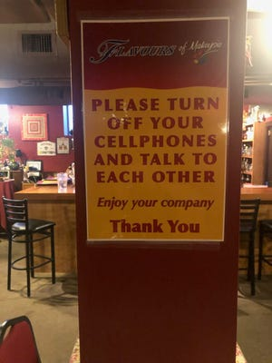 A sign at Flavours restaurant in Pittsfield, Massachusetts implores customers to put away their phones.