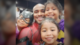 These little girls find their favorite comic book hero in the park, but the real super hero is underneath the mask.