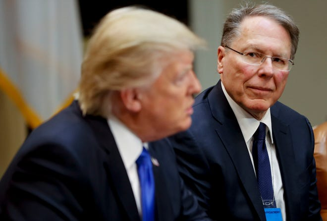 National Rifle Associations Executive Vice President and Chief Executive Officer Wayne LaPierre listens at right as President Donald Trump speaks in the Roosevelt Room of the White House in Washington in 2017.